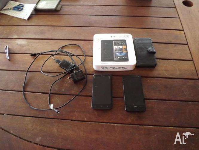 1 htc one 801s in box with charger and 1 htc one desire
