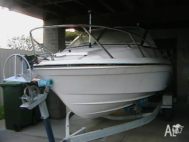2007 model 5.5 metre fibreglass hull and trailer