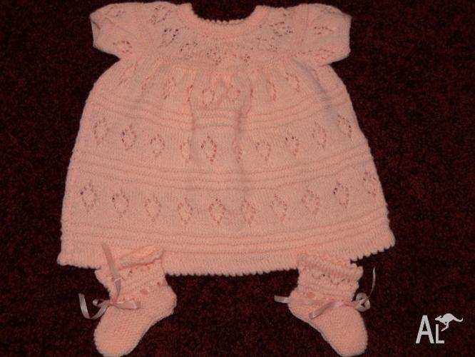 4 HANDKNITTED BABY DRESSES - NEW AND USED