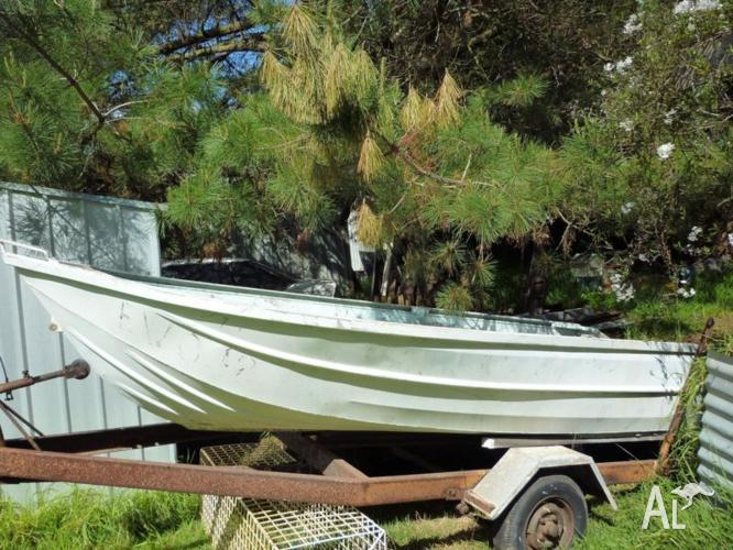 Aluminium 12 ft boat on trailer