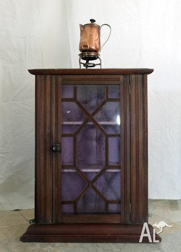 Antique french mahogany corner cupboard with glass door
