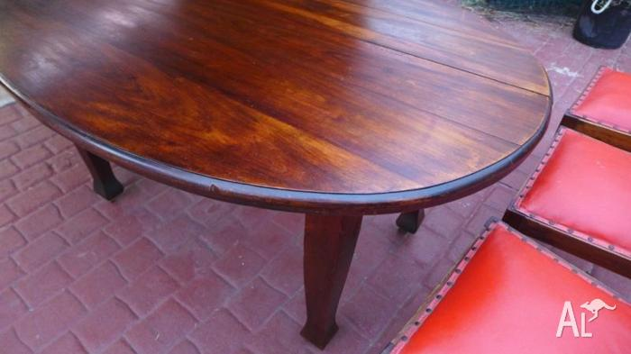 ANTIQUE TIMBER OVAL DINING TABLE WITH MATCHING CHAIRS