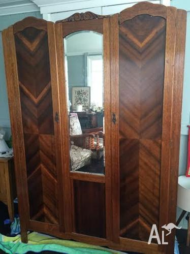 Antique Wardrobe. Ornate trimming, two door and mirror