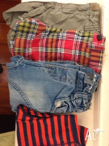 Assorted designer boys clothes and shoes