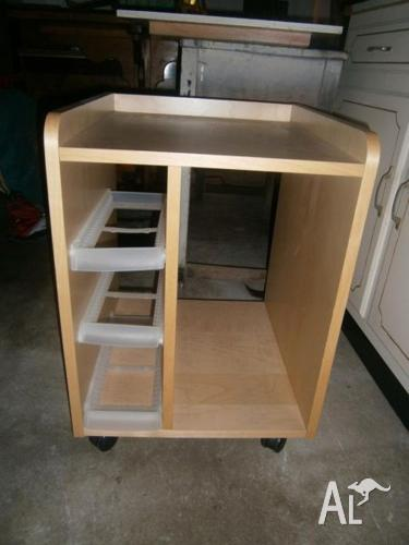 ATTRACTIVE AND HANDY CABINET ON WHEELS