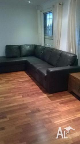 Black Bonded Leather L-Shaped Couch in as new condition
