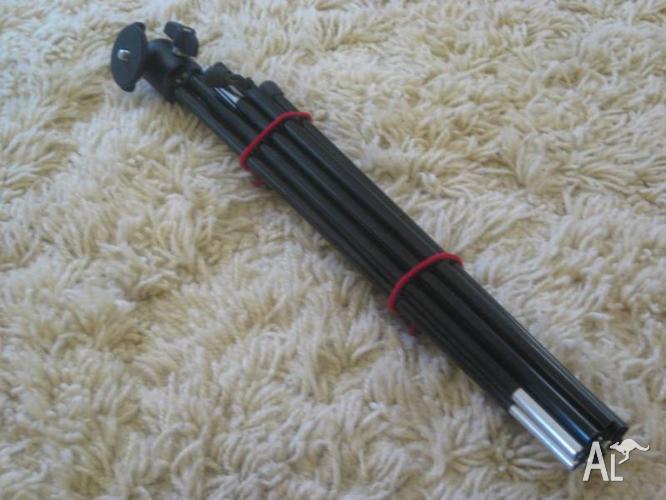 Black Lightweight Folding Camera Tripod -folds up like