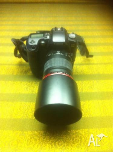 CANON D60 With 135mm Lens.
