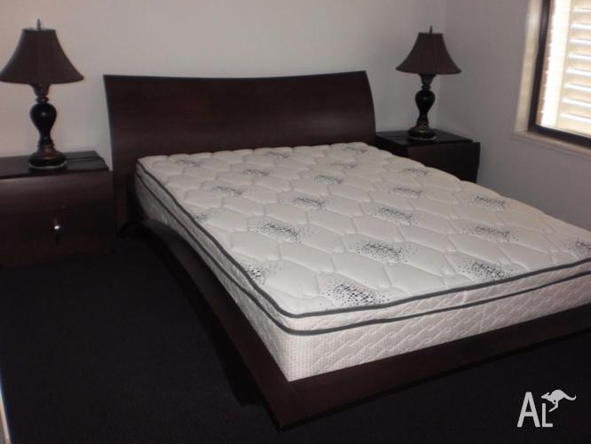 Classy queen size bed with near new mattress and side