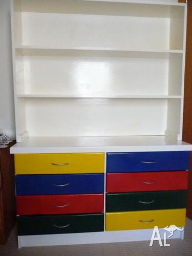Colourful chest of drawers and hutch