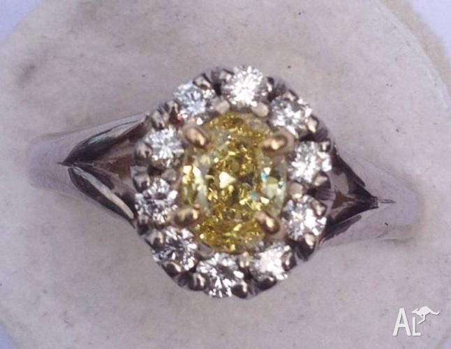 Fancy Yellow vivid Diamond on white gold, high grade &