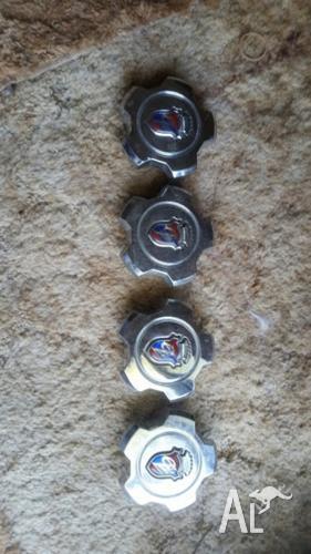ford xf fairmont ghia showflake alloy wheel center caps