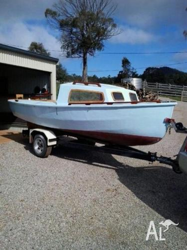 Hartley boat on tilt trailer with reg