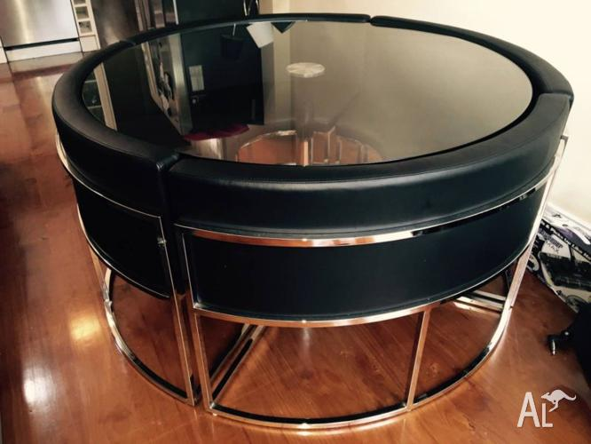 Hideaway Round Glass Dining Table with 4 Black Chairs
