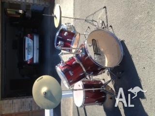 metalic red powerbeat drums