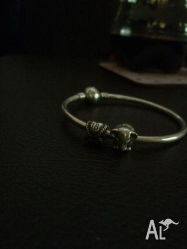 Pandor bracelet with charms