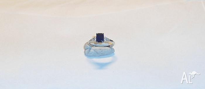 Sapphire and diamond white gold ring.
