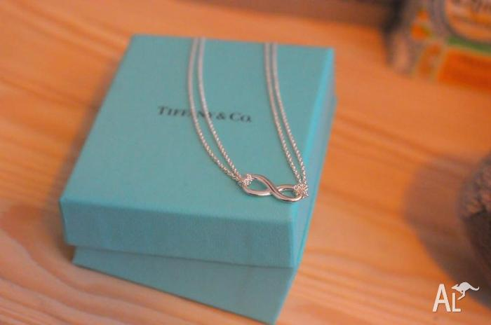 TIFFANY AND CO. STERLING SILVER INFINITY NECKLACE