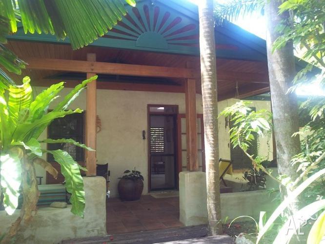 Unique tropical home on acreage