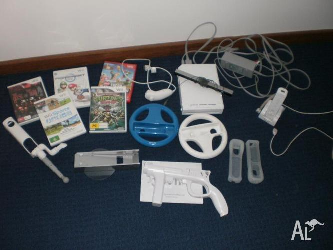 Wii console and 4 games and accessories