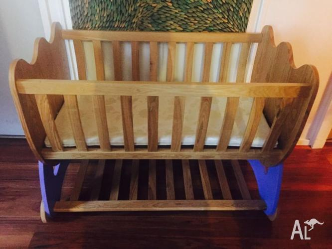 Wooden Bassinet with latex mattress.