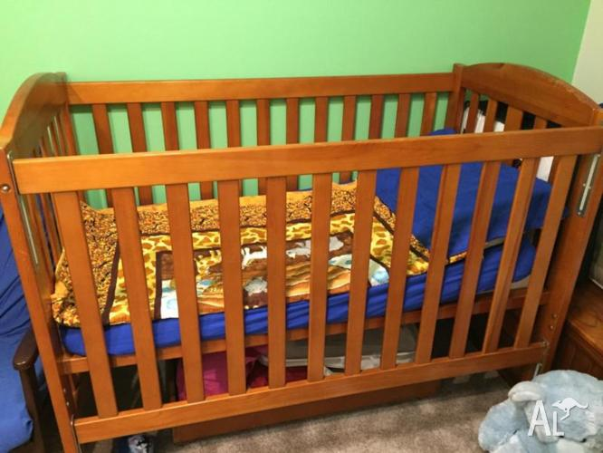 Wooden cot with change table and drawers