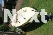 Laser 2 dinghy on trailer with rig