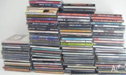 For sale is a bulk lot of about 100 used grunge CDs.