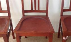 10 Antique timber dining chairs. Very solid and in good