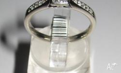 10k white gold ladies engagement ring featuring 4x