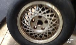 "14"" Rim to suit commodore Tire is bald, holds air. No"