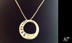 14ct W.G, 0.29ct Diamond Circle Pendant & Chain worth
