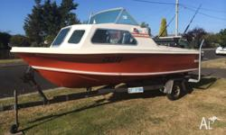 15 foot Nova half cab 55 Hp Evinrude electric start and