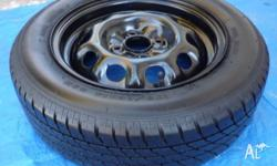 175 � 65 R14 Complete wheel with approx 85 to 90 % of