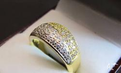 This cast made 18ct yellow band style ring has 58 small