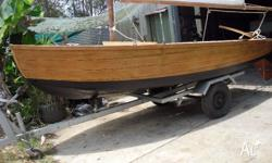 This fully restored 1945 Bunya pine racing boat. This