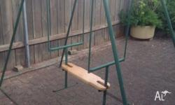 1960's metal swing with new wooden seat has enjoyed