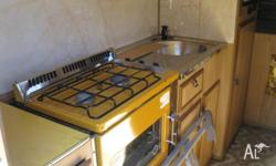 1980s slide on camper with 3 way fridge gas stove oven,