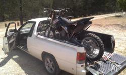 Good old work ute, perfect for the keen moto rider,