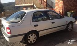 1991 Nissan Pulsar SSS 4 door manual, white,
