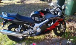 Black Honda CBR600F. 1999 model. 30,000k's.4 cyl. .