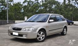 For sale is Mazda 323 Astina AUTO with 6 MONTHS REGO