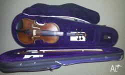 1/8 Violin. Only 7 months old. The violin just got