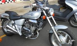 AWESOME LOOKING SILVER HONDA VT 250 LOOKS BIGGER BUT