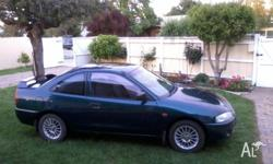 2001 Mitsubishi Lancer. Registered until November 2013.