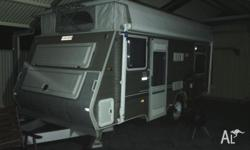 Pop top off-road Rear island double bed Front dinette,