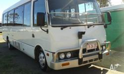 We have a 2003 Mitsubishi Rosa bus for sale for