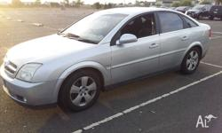 hi guys its holden vectra CDX. fully automatic {comes
