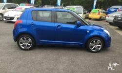 2006 Suzuki Swift in Bright Blue with tinted windows