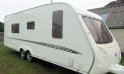This 2006 Swift Conqueror 630 SAL is a beautiful twin